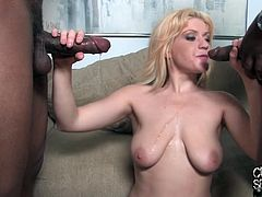Masturbate watching this blonde babe, with a nice ass wearing high heels, while she goes hardcore with two black fellows over a couch.