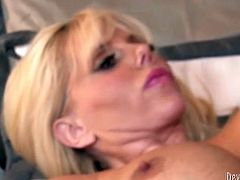 Naughty blond haired mature whore suck her stud's dick and moans loud while getting her holes hammered hard doggy style.