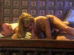 Awesome blonde milf Jessica Drake is getting naughty with two men in a bedroom. She sucks and rubs their weiners and then gets her shaved vagina pounded in cogirl position and doggy style.