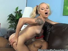 Prepare your cock for this tattooed blonde in pigtails, with natural boobs wearing a miniskirt, while she has interracial sex with a big black cock.