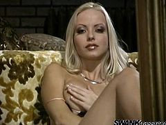 Press play to watch this blonde babe, with big knockers wearing sexy lingerie, while she takes her clothes off and touches herself.