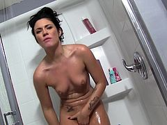 Pretty brunette Andy San Dimas is having a good time in the shower. She washes and strokes her flawless tattooed body and enjoys herself.