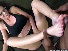 Brooklyn Chase is ready to have some fun with a huge black cock from the hood. She takes off her stockings and starts to stroke this shaft to make him cum.