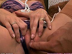 Bodacious mommy with light hair in glasses Angela Attison looks super sexy in her lingerie and nylons. Milfie spreads her legs wide open and gets her shaved cunny fingered.