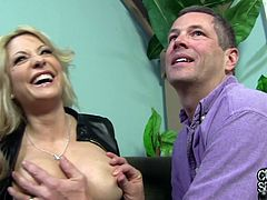 Captivating blonde milf Helly Mae Hellfire is having fun with some man indoors. She shows her big fake boobs for the cam and allows the guy to knead them.