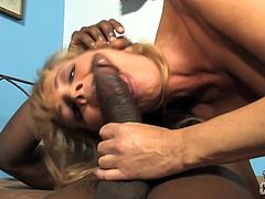 Share this with your friends! A blonde cougar, with a nice ass and big knockers, while she gets plowed hard and sucks a big dick at the same time.
