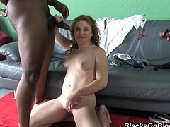 Charming redhead girl Lucy Fire is having interracial threesome MMF sex. She pleases the dudes with a blowjob and then gets her snatch drilled doggy style and in other positions.