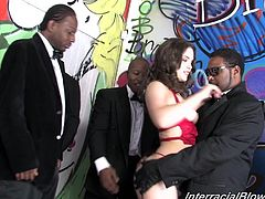 Horny brunette slut Janet Mason is having fun with a few black dudes indoors. She sucks and rubs their hard shafts and feels happy to get a bukkake.