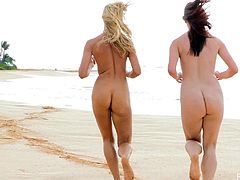 These sexy girls hit the public beach, stripped off their bikinis, and played around in the sand and surf completely naked.