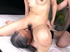 Slutty dark haired asian slut Nozomi Aiuchi gets her hairy snatch eaten while she is sucking other guy's cock and then guys switch.