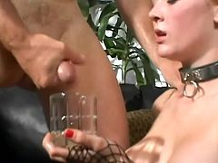 Nasty redhead girl gets face fucked by two guys. She gets so damn horny that asks for double penetration. Then dudes cum into a glass and she drinks it all.