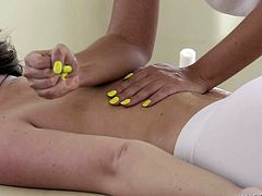 The masseuse and her client arrive to the massage table at the same time. The masseuse takes of her sweatpants and the client slips out of her daisy dukes; they both show off their amazing asses. The masseuse rubs oil all over the client's body - including her round ass.