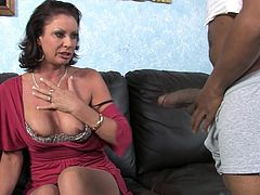 Witness this video where a brunette cougar, with a hairy pussy and big breasts, has interracial sex with a black guy and moans loudly.