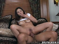 Asian babe masturbates on the couch alone but not for long! The guy approaches her and fills her pussy with his dick. She rides him on the couch in reverse cowgirl and moans with delight as the dick goes deep in her anus. The deeper the better and this bitch is about to receive all that she craves for