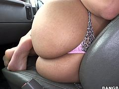 Who the fuck can say no to a hot redhead that wants some fun? Well, this guy couldn't so he entered the car at her request and had some fun! She took off his pants, firmly grabbed his penis and started to suck it. The slut then went on top of him and rode his cock with her big booty. Now that's a hot ride!