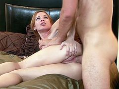 Her shaved twat is about to get devoured by this massive cock