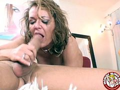 Big breasted slutty cougar Kelly Leigh gets totally undressed and pleases her partner by sucking his big cock and balls.