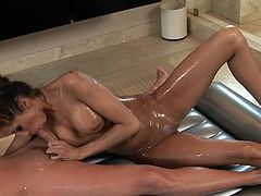 Watch how she goes down in a staggering erotic massage porn scene