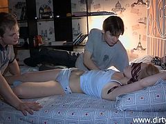 This boy had enough with his slutty gf and wants to give her a lesson. He tied her hands on the bed's frame, blindfolded her and called in a friend. The two then started to touch the blonde cutie, undress her and fill her pussy with cock. Seems like the blonde will have to endure this kinky threesome!