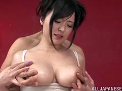 Very sexy Japanese girl in a wet t-shirt gets her tits felt up while she uses her skilled hands to massage this guy's cock.