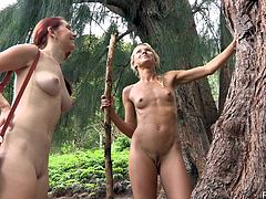 Nude hussies Melody and Lena Hawaii are having fun in the forest. The blonde and the redhead pet each other and then sit down on the ground and play with their twats.