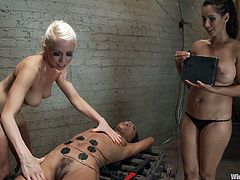 Marie is a beautiful lady with a pair of superb thighs, a hairy snatch between them and a very pretty face. This fit & healthy brown babe is tied on a bondage table as these two electro mistresses attache electrodes on her sexy abs. The bitches then turn on the power and the blonde one fingers her pussy.