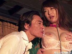 This Japanese slut is tied to a huge wooden pole and made to watch, her man fuck her best friend. Her tears off the tank top and makes her get down to her knees, to suck on his throbbing pecker. She has to look, as he fucks her from behind.