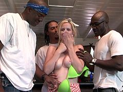 Make sure you have a look at this hardcore scene where the slutty blonde Tara Lynn Foxx is gangbanged by black monster cocks until her mouth's filled by cum.