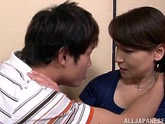 This Japanese mature lady, is going to show her much younger boyfriend a thing or two. She has sucked many cocks in her lifetime and today, she is going to show, what she has learned. They kiss passionately and soon she's on her knees, while her husband is in the other room, reading the paper and drinking.