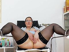 Check out Dorotha slamming a big toy up her greedy twat