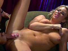 A magnificent blonde MILF gets her delicious pussy licked and fingered. She gives a skillful blowjob in return. Then Carolyn gets fucked hard on an armchair.