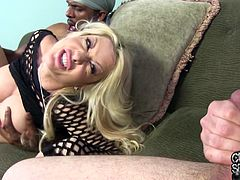 Get excited watching this blonde cougar, with giant boobs wearing fishnets, while she goes hardcore with a steamy dude and moans stridently.