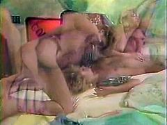 Slutty and filthy black bitches fuck with double headed dildo meanwhile three horny sluts lick each other's clits. Have a look in steamy The Classic Porn sex clip.