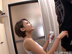 Japanese cutie Karen Aoki and her man are having some good time in a bathroom. Karen sucks the man's boner ardently and also shows her ass-licking skills.