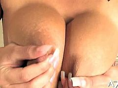 Carmella Bing has an impressive pair of tits and a very hot attitude. She plays with a realistic dildo.
