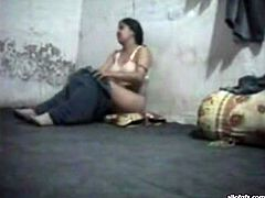 Kinky and slutty brunette with nice body and good ass takes her clothes off on the floor. Have a look in steamy The Indian Porn sex clip.