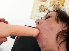 With a big toy ready for her cunt, hairy nurse starts masturbating at work