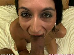 Comely black haired hooker Nikki Daniels is great at blowjobs. Sweetie shows off her shaved pinkish cunt and then gives her buddy breat taking blowjob.