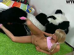 Young and naughty blonde Amelie Pure gets nailed by huge dildo