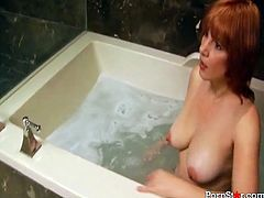 Sexy red head enjoys her warm bath with bubbles, and decides to give her man a deepthroating blowjob and titjob while in the bathtub.