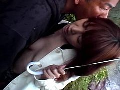 Lovely Asian teen skank exposes her delicious small boobies outdoors. One horny bloke plays with her sweet round tits before giving his full attention to her delicate pussy. She moans passionately while he is using her fingers to tease her lovely little pussy before fucking her hard from behind.