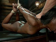 Black babe Ana is tied by her hands and hanged by Pete. Pete behaves like a real master and teaches Ana her place. He fucks her mouth and fingers her black pussy while she hangs. Look at this beautiful black bitch being sexually used and dominated by white man, she loves it that way!