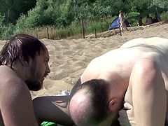 Two cocks on a shaved twat during nasty outdoor porn scene