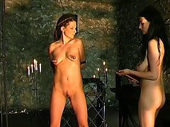 Nasty lesbian mistress with hairy pussy and huge tits enjoys sizzling pussy torturing with hot brunette slave.