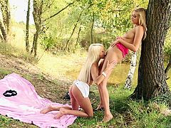 Jese and Holly are two cute blondes, that love nature and to fuck! Here they are, having a picnic in the middle of the forest, when they started acting slutty. The blondes went really wild with each other and started to lick their cunts. Wanna know, what else they've did in the woods? Don't miss them!
