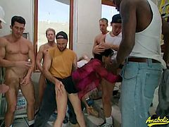 Claudia Adkins gets gang banged by a group of body builders. They pound her pussy and fuck her throat.