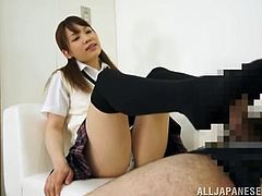 Ria likes to play and this time she does it with her feet. The guy she's with is blindfolded and enjoys her soft touches as she massages his cock with her feet. What a naughty Nippon cutie, wonder if she will get a load of cum on those black socks?