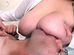 Get excited watching this Asian brunette, with natural boobs wearing a shirt, while she goes wild with an aroused man who loves nipples.