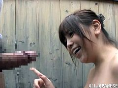 This cute Japanese girl is enjoying the great outdoors and fresh air, while relaxing in this onsen. She sees an old man come in and she can sense, he is in need of some sexual healing. She plays with his dick, lather it up and gives his peehole a lick.