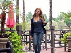 Click to watch this redhead babe, with natural boobs wearing glasses, while she gets naked in the middle of the street doing a solo model video.